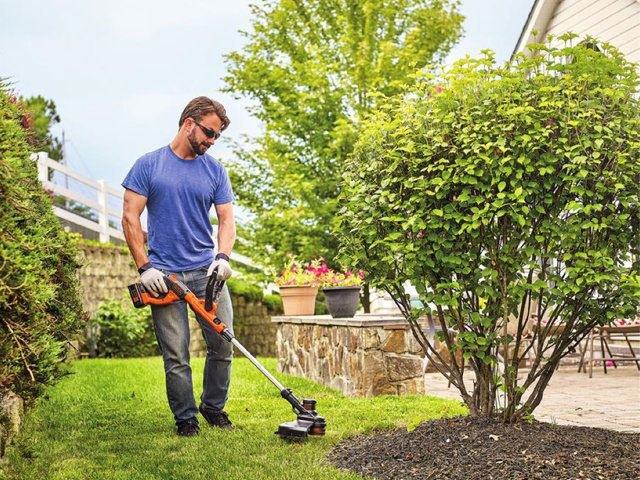mowing lawn with string trimmer